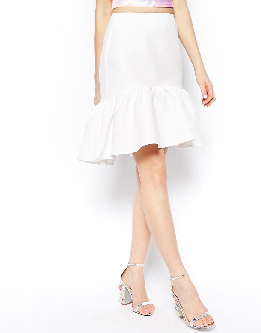 Image 4 ofASOS Mini Skirt In Texture With Peplum Hem