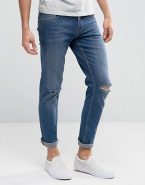 ASOS Stretch Slim Jeans With Knee Rips In Mid Wash Blue