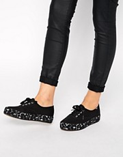 Shop Keds online and buy Keds Triple Black Flatform Plimsoll Trainers