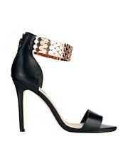 Shop Dune online and buy Dune Huffy Gold Strap Black Heeled Sandals