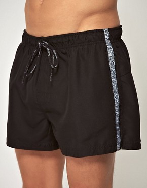 Image 1 ofCalvin Klein Logo Tape Swim Shorts