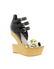 DV8 Jeopardy Cut Out Leather Wedges