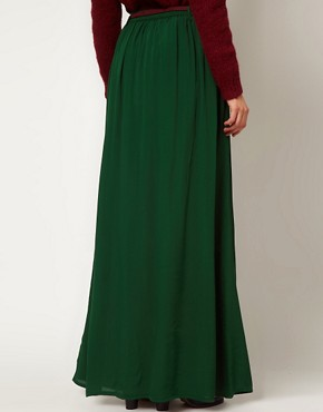 Image 2 ofGanni Madison Maxi Skirt in Dark Green with Burgundy Belt