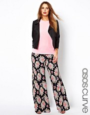 ASOS CURVE - Pantaloni con fondo ampio vintage a fiori