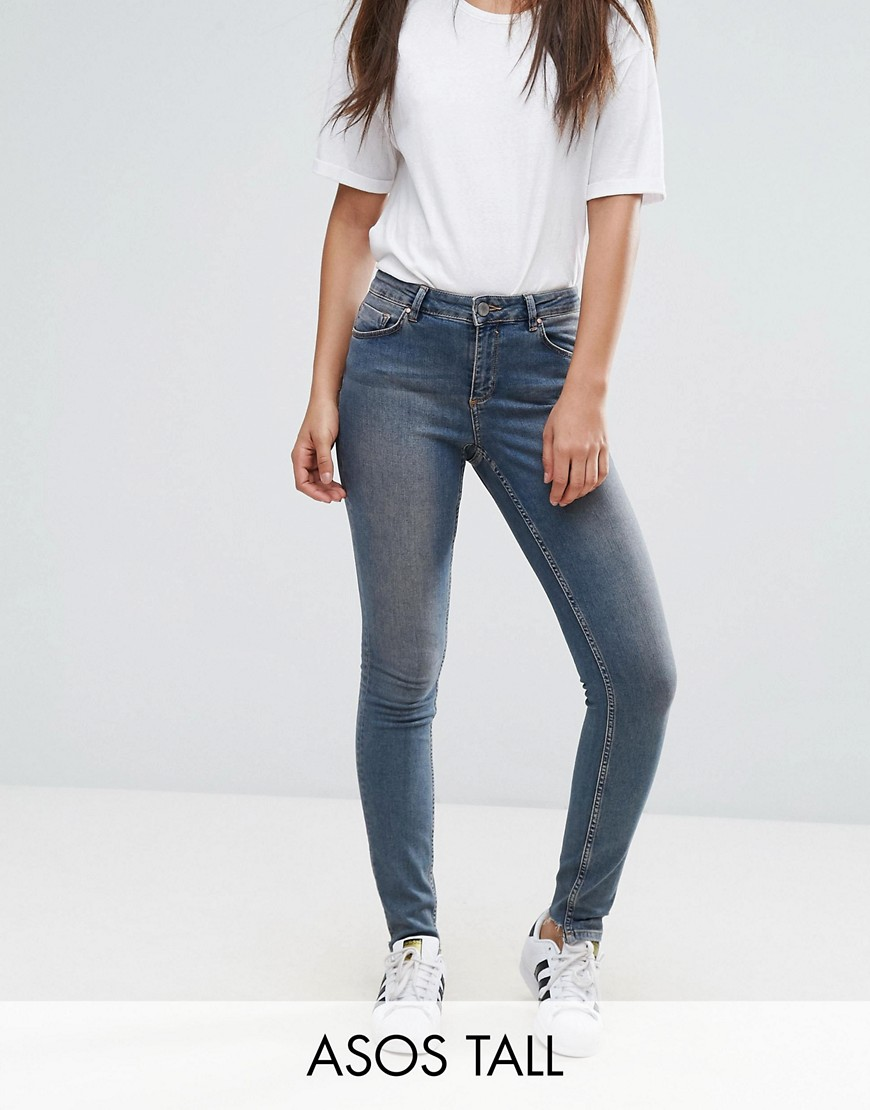 ASOS TALL LISBON Skinny Mid Rise Jeans in Dita Tinted Mid Wash with Reverse Stepped Hem - Mid wash blue