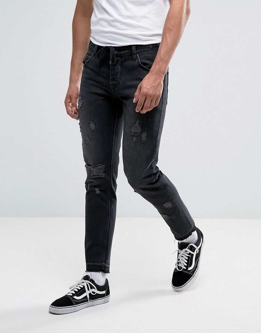 ASOS Slim Ankle Grazer Jeans In Washed Black With Distressing And Drawcord - Washed black