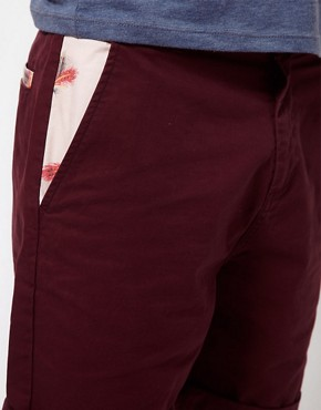 Image 3 ofASOS Chino Shorts With Feather Print Pockets