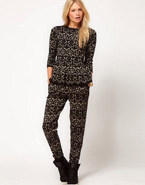 Image 1 ofASOS Knitted Jogger In Metallic Paisley