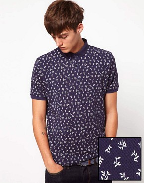 Image 1 ofASOS Polo With All Over Ditsy Print