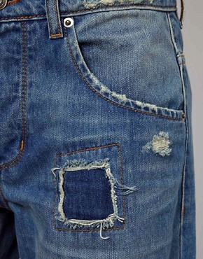 Image 3 ofASOS Saxby Boyfriend Jeans in Light Wash Vintage Rip and Repair