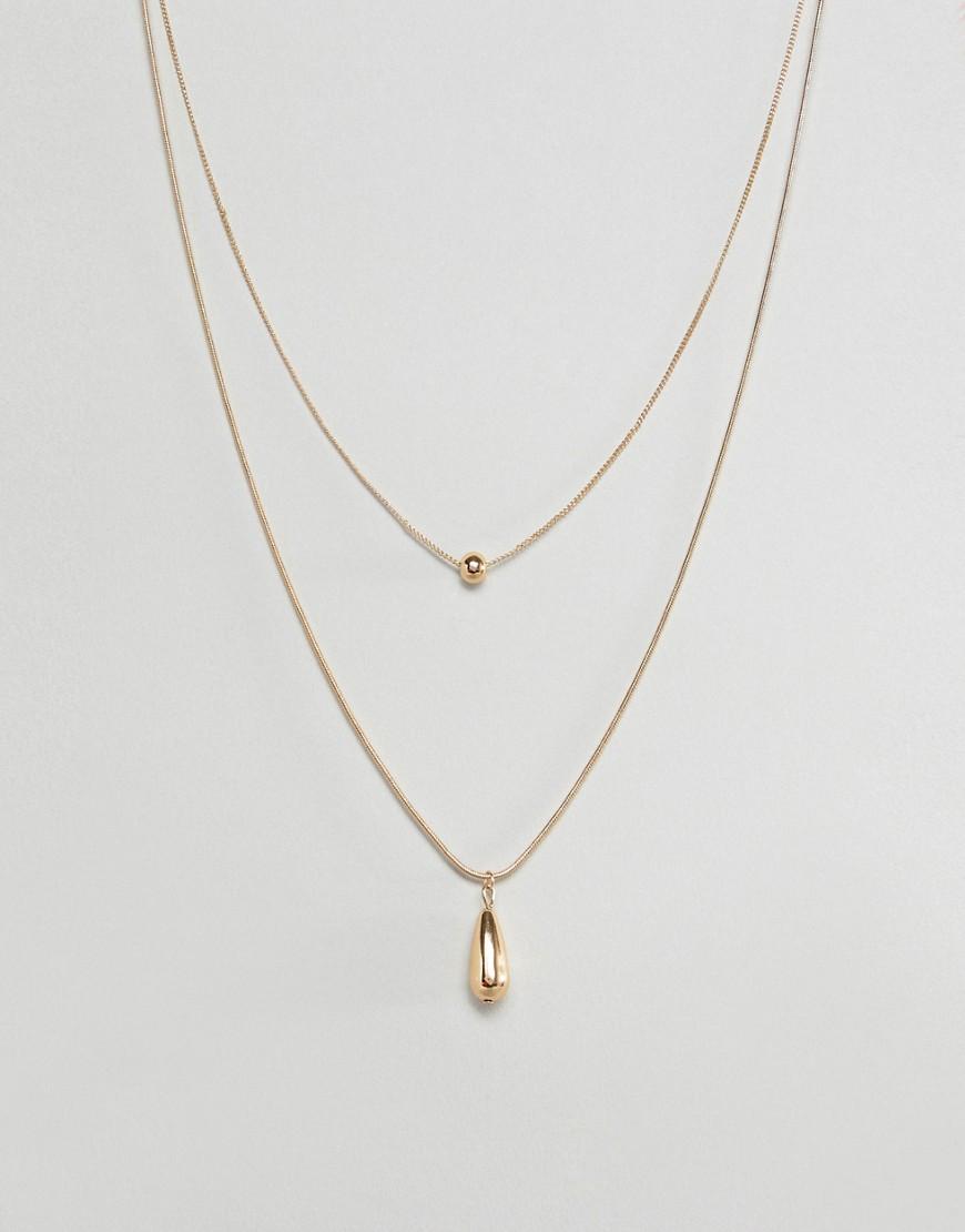Золотистое ожерелье в несколько рядов с шаром и каплевидной подвеской ASOS DESIGN