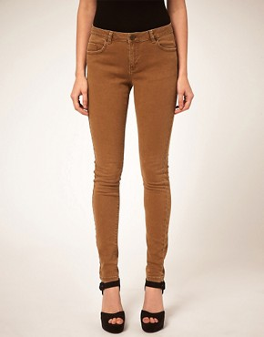 Image 1 ofASOS Washed Camel Skinny Jeans