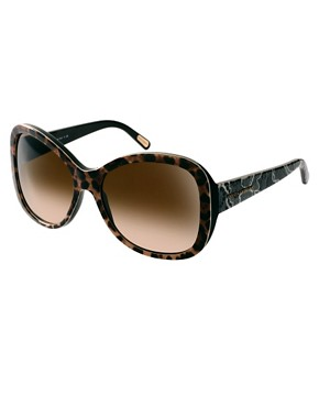 Image 1 ofDolce And Gabanna Mix &amp; Match Leopard Print Sunglasses