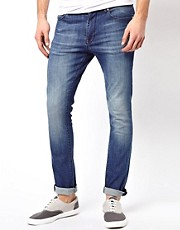 ASOS Super Skinny Jeans In Washed Blue.