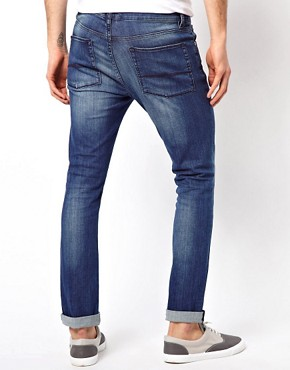 Image 2 ofASOS Super Skinny Jeans In Washed Blue.