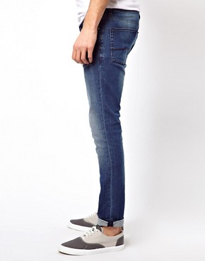Image 4 ofASOS Super Skinny Jeans In Washed Blue.