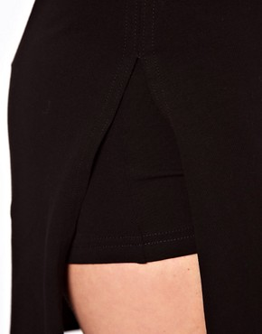 Image 3 ofASOS PETITE Exclusive Cutout Panel Skirt With Shorts