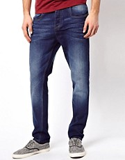 Vaqueros tapered en azul desgastado de ASOS