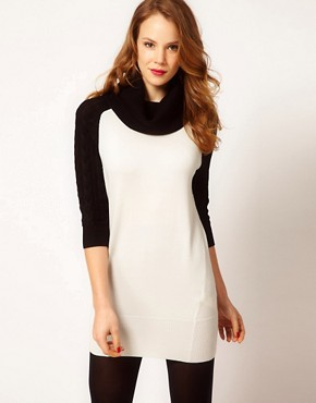 Image 1 ofKaren Millen Jumper Dress with Roll Neck and Contrast Raglan Sleeves