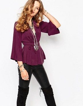 Free People Grand Piano Wrap Top with Peplum Detail