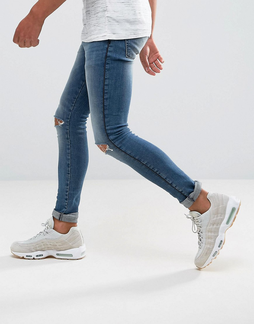 ASOS Extreme Super Skinny Jeans In Mid Wash With Rips And Side Detail - Mid wash blue