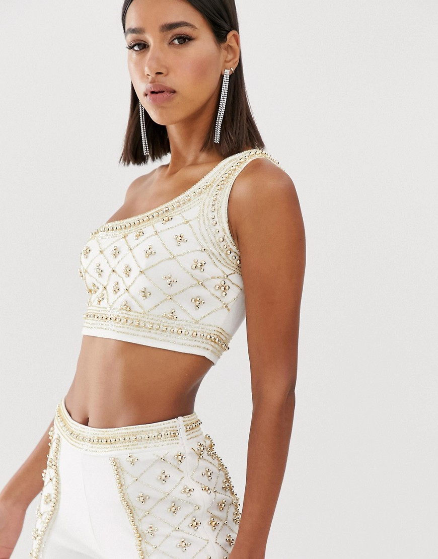 Starlet embellished longline one shoulder crop top in white and gold
