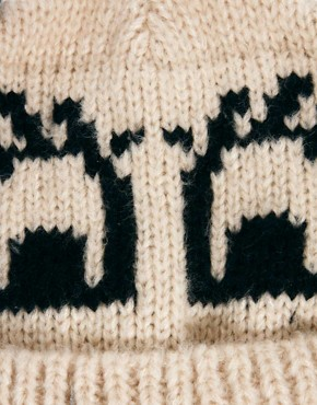Image 3 ofASOS Flutter Eyes Pom Pom Beanie