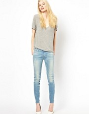 7 For All Mankind Mid Rise Ripped the Skinny Jeans