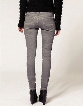 Image 2 ofASOS Grey Skinny Jeans With Pigment Wash #4
