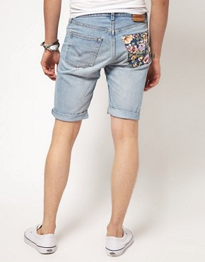 Image 1 ofReclaimed Vintage Levis Shorts with Floral Pocket