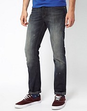 Adidas Originals Slim Jeans In Heavy Worn Wash