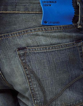 Image 4 ofAdidas Originals Slim Jeans In Heavy Worn Wash