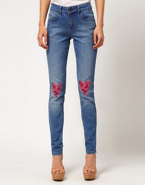 Image 1 ofASOS Skinny Jeans with Heart Knee Print #4