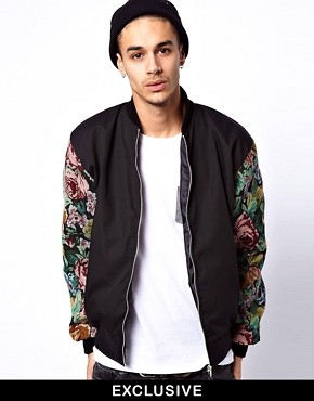 Image 1 ofReclaimed Vintage Varsity Jacket with Floral Sleeves