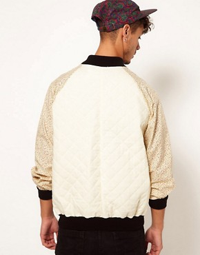 Image 2 ofReclaimed Vintage Quilted Varsity Jacket with Floral Sleeves
