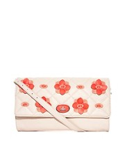 Clutch con detalle de flores Star To Fall de Fiorelli
