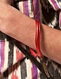 Image 3 ofASOS String and Feather Bracelet