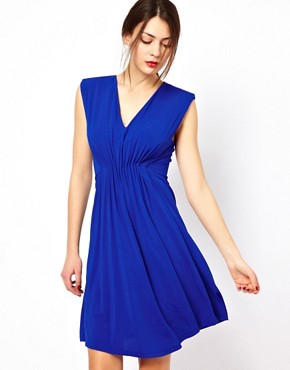 Image 1 ofSee By Chloe Slinky V Neck Dress with Shoulder Pads and Rouching