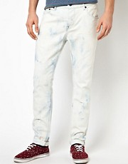ASOS - Jeans slim fit con strappi ed effetto candeggiato