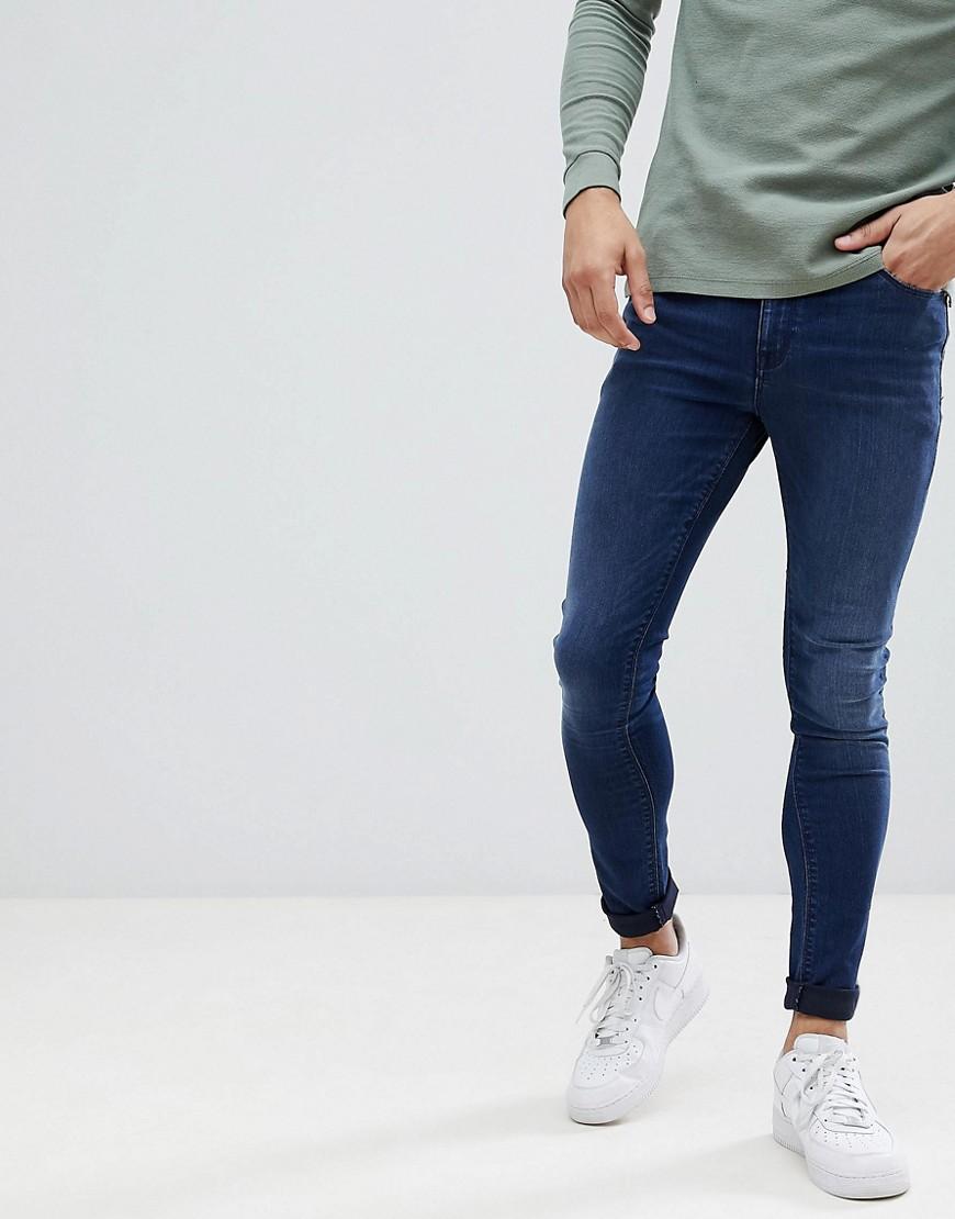 Фото - Темно-синие джинсы ASOS DESIGN - Синий синего цвета