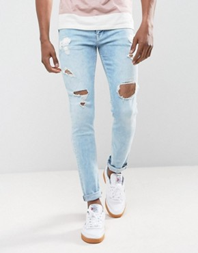ASOS Skinny Jeans In Light Wash Blue With Heavy Rips