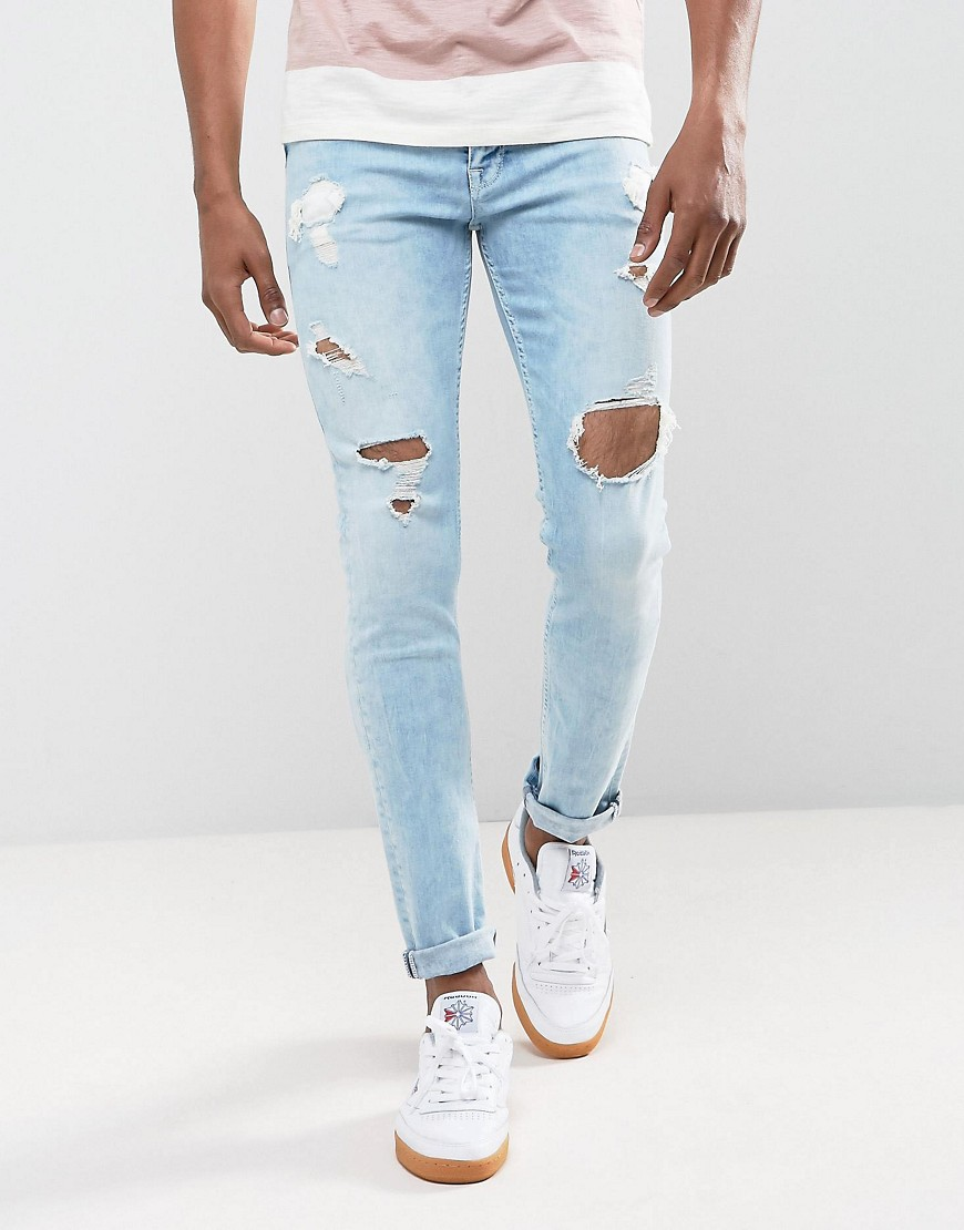 ASOS Skinny Jeans In Light Wash Blue With Heavy Rips - Light wash blue