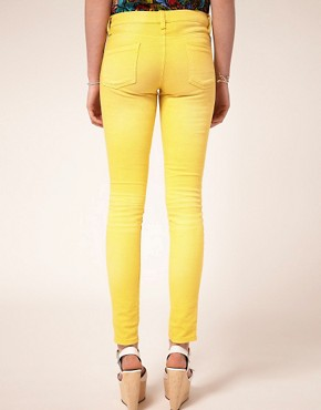Image 2 ofASOS Yellow Skinny Jeans with Abrasion