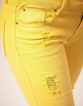 Image 3 ofASOS Yellow Skinny Jeans with Abrasion