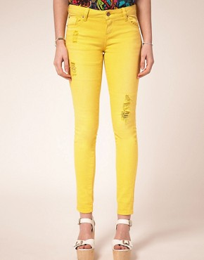 Image 1 ofASOS Yellow Skinny Jeans with Abrasion