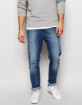 ASOS Stretch Tapered Jeans In Mid Wash