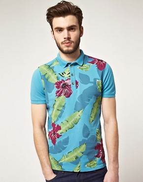 Image 1 ofASOS Polo With Hawaiian Print