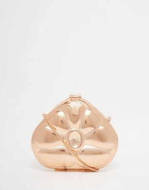 From St Xavier Rose Gold Clutch With Tear Drop Embossing