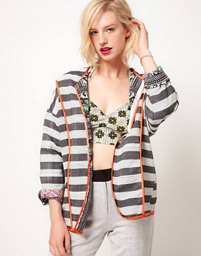 Image 1 ofASOS AFRICA Oversize Jacket In Reversible Print