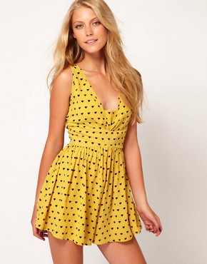 Image 1 ofASOS Flippy Short Playsuit in Heart Print